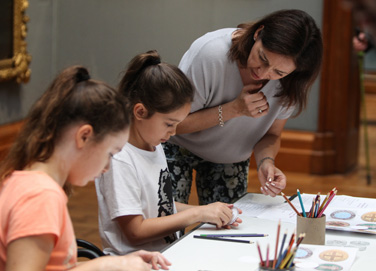 Families, parent and children in drawing workshop
