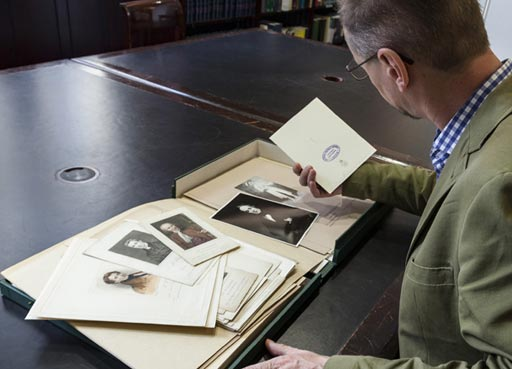 Visit the collected archives, member of the public looking through the archives